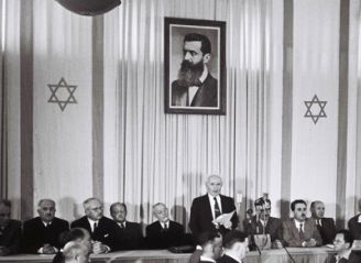 "Fulfilling Prophet Ezekiel s prophesy in the book of Ezekiel chapter 37 re-"" valley of dry bones "",President of the provincial council, David Ben Gurion read aloud the declaration of the establishment of the state of Israel in 1948."