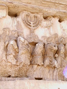 220px-Carrying_off_the_Menorah_from_the_Temple_in_Jerusalem_depicted_on_a_frieze_on_the_Arch_of_Titus_in_the_Forum_Romanum